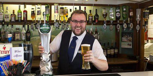 Barman-servering-drinks-at-hotel